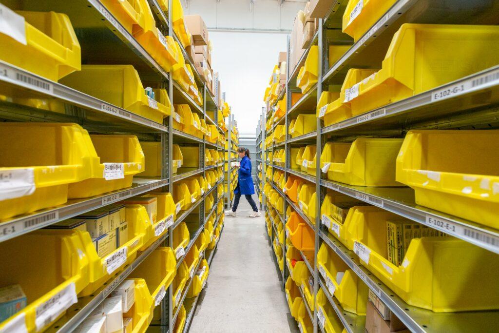 yellow plastic crates on white floor tiles